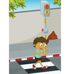 Boy crossing road vector image