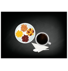 Hot coffee and raisins or dried grape on chalkboar vector