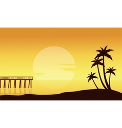 Silhouette of beach with pier scenery vector
