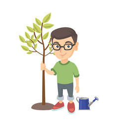 Caucasian smiling boy in glasses planting a tree vector