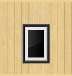 Picture frame hanging on the wooden wall vector
