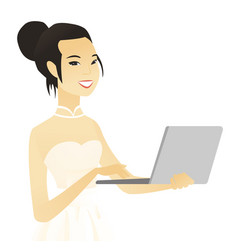 Young asian bride in a white dress using a laptop vector