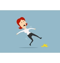 Businesswoman slipping on a banana peel vector