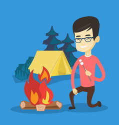 Young man roasting marshmallow over campfire vector