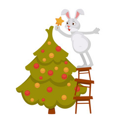 funny bunny decorates christmas tree and stands on vector image