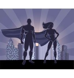 Superhero and female superhero silhouettes vector image
