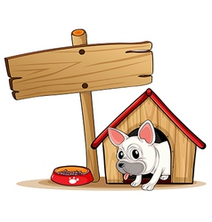 A wooden signboard beside a doghouse vector image vector image