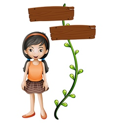 A girl standing beside a signboard vector image