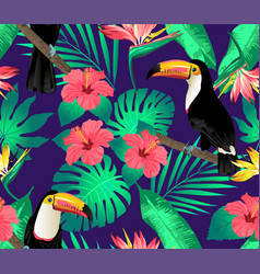 Tropical birds and palm leaves seamless vector