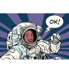 Ok gesture woman astronaut in a spacesuit vector