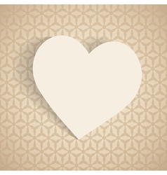 a paper heart on the beige background vector image