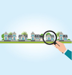 Magnifying glass in human hand with house icon vector