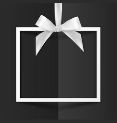 White gift box frame with silky bow on black vector image vector image