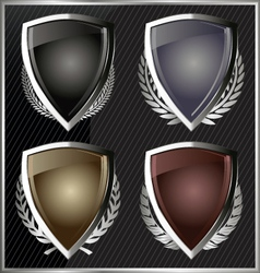 Silver shields with laurel wreaths vector