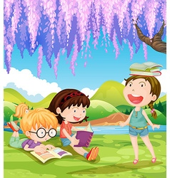 Children reading books under the tree vector image
