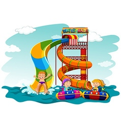 Boys and girl riding down the water slide vector
