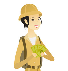 Young asian traveler holding money vector