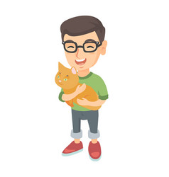 Caucasian happy boy in glasses holding a cat vector