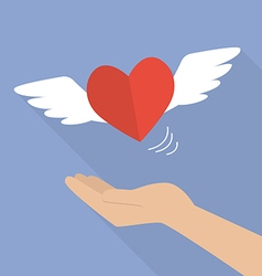 Hand with heart flying vector image