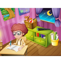 A boy writing inside his room vector image vector image