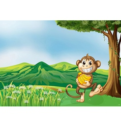 A monkey holding a banana vector image vector image