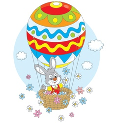 Easter bunny in a balloon vector