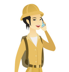 Young asian traveler talking on a mobile phone vector