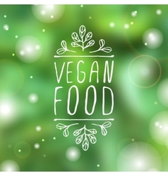 Vegan food - product label on blurred background vector image vector image