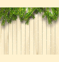 christmas tree branches on light wooden background vector image vector image