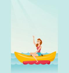 Young happy caucasian woman riding a banana boat vector