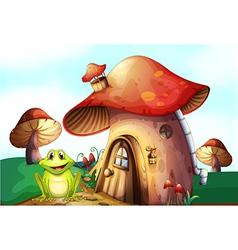 A frog beside a mushroom house vector