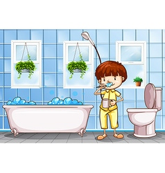 Boy brushing teeth in the bathroom vector