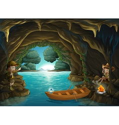 A young girl and boy inside the cave vector image vector image