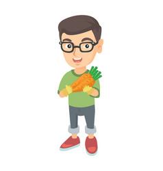 Caucasian boy in glasses holding fresh carrot vector