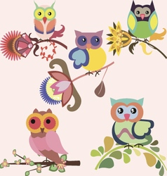 Set of cute multicolored owls sitting on flowers vector