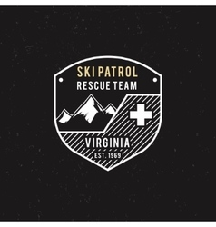 Winter ski patrol rescue team label with vector