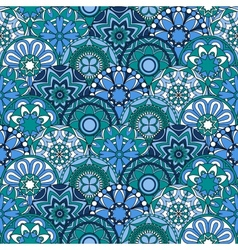 Seamless pattern with blue circles and floral vector