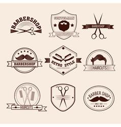 Barbershop badges set in vintage style vector