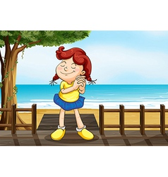 A girl wishing at the wooden bridge vector image