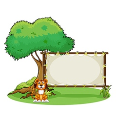 A tiger beside a rectangular signage vector image