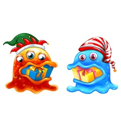 Christmas theme with two monsters and gifts vector