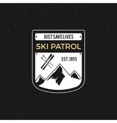 Winter ski patrol label with ski equipment and vector