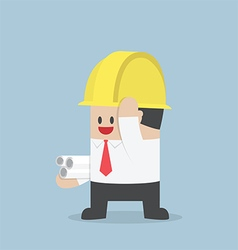 Businessman in yellow safety helmet with sheet rol vector image vector image