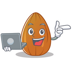 with laptop almond nut character cartoon vector image
