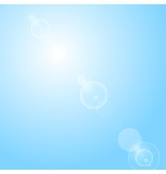 Shiny lens flare on blue sky vector