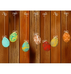 Easter eggs on a wooden wall EPS8 vector image