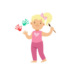 Happy smiling little blond girl painting white vector