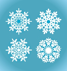White snowflakes on a blue background vector