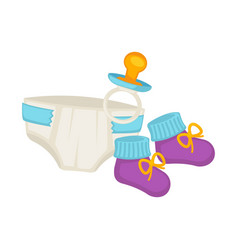 Baby diapers knitted booties and small pacifier vector