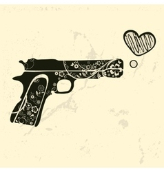 Love gun vintage emblem with gun shooting a heart vector